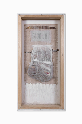 Trina Carlson, HEAVY HUNG, 2013, Vintage carpenters pouch, saw blade, tow strap, cotton, burlap, cheesecloth, branch, thread, 36 X 18 in.